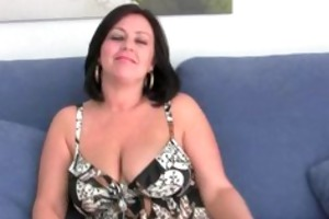 aged mom with large scoops pinches her nipples