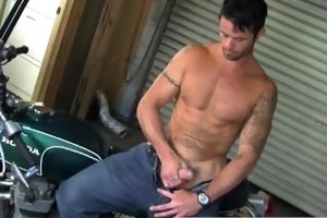 stroking cock on his motor bike
