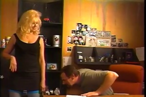 breasty aged blond in thigh-highs kneels to suck