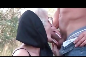mature paramour taking young ramrod on knees