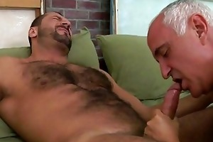 an old man is engulfing his fellows rod
