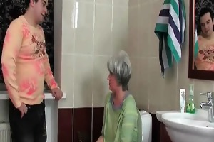 excited dude enters the bathroom where her aged