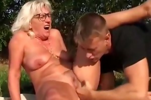 romanian hairy granny with young boy
