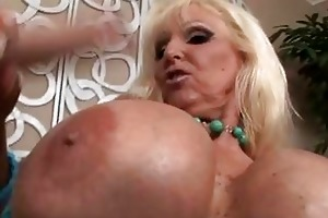 tanned blonde with biggest mambos sucking younger