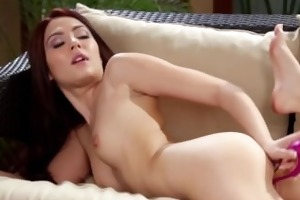 youthful redheaded handling sex-toy in solo