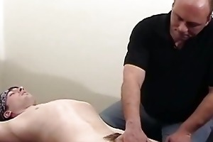 dad gives massage to cute son