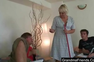 old cleaning woman takes hard juvenile knobs