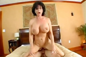 mature brunette with big zeppelins bonks with her