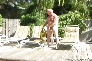 dad chuck plays with himself and some sun lotion