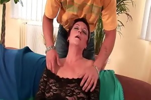 hot grandma enjoys his cock in her throat and