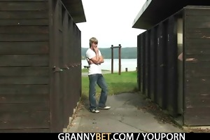 granny is gangbanged in the public area