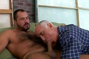 an old man is sucking his boyfrends schlong