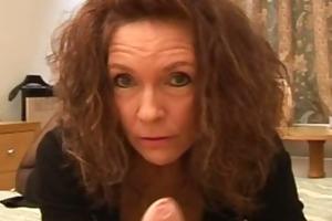 aged brunette gives a harsh handjob