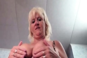 breasty old woman shows her massive tits and