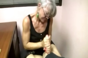 cougar mother is buffing the cock
