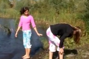 juvenile models fingering by the river