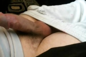 young chap stroking his pretty pecker until cums