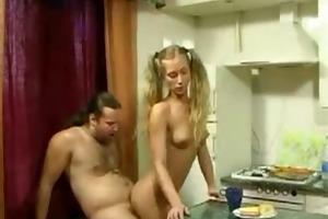 daughter tempt old man in kitchen