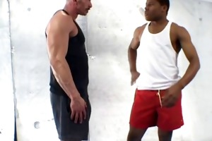 old muscleman lets a huge darksome shaft up his