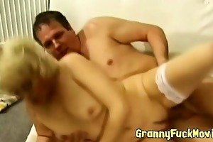 golden-haired grandma sucks penis