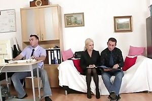 old blonde takes two cocks
